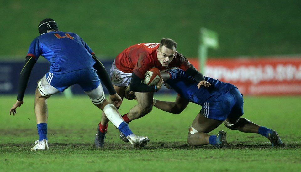 16.03.18 - Wales U20s v France U20s - Natwest 6 Nations Championship - Ioan Nicholas of Wales is tackled by Camero Woki of France.