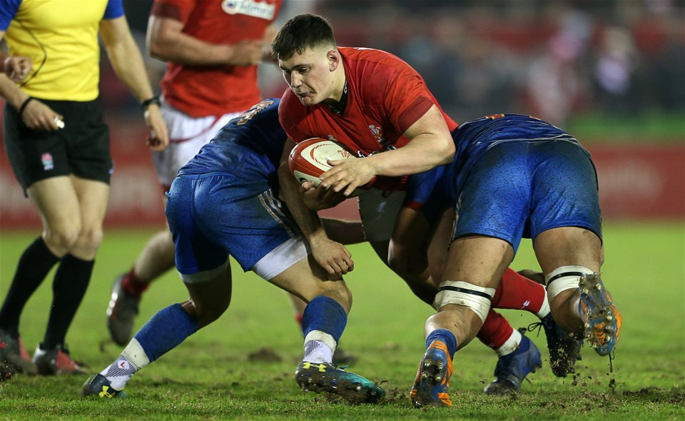 16.03.18 - Wales U20s v France U20s - Natwest 6 Nations Championship - Will Griffiths of Wales is tackled by Jules Gimbert and Sacha Zegueur of France.