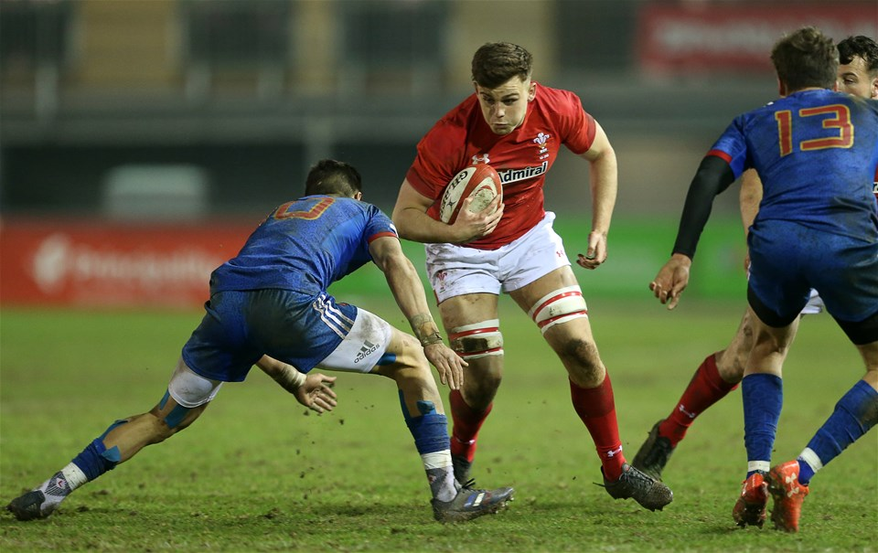 16.03.18 - Wales U20s v France U20s - Natwest 6 Nations Championship - Lennon Greggains of Wales is tackled by Romain Ntamack of France.