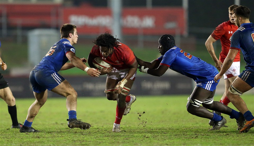 16.03.18 - Wales U20s v France U20s - Natwest 6 Nations Championship - Max Williams of Wales is tackled by Lucas Peyresblanques and Ibrahim Diallo of France.