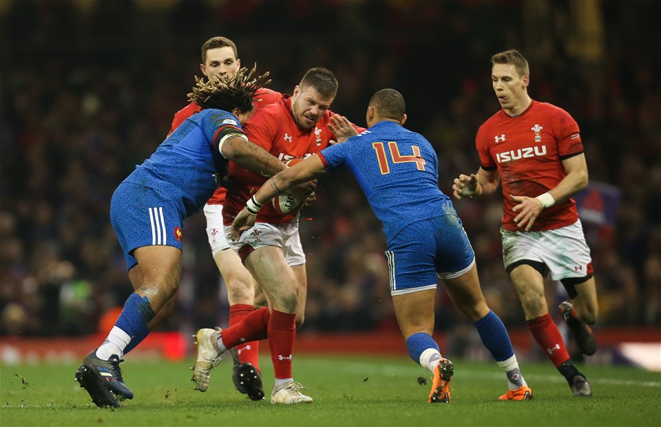 17.03.18 - Wales v France, NatWest 6 Nations 2018 - Rob Evans of Wales is tackled by Mathieu Bastareaud of France and Gael Fickou of France