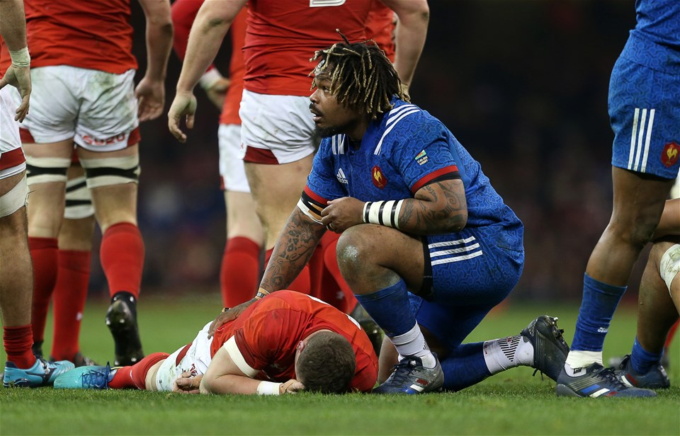 17.03.18 - Wales v France - Natwest 6 Nations Championship - Mathieu Bastareaud of France checks if Scott Williams of Wales okay after receiving a knock to the head.