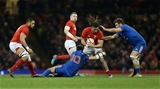 17.03.18 - Wales v France - Natwest 6 Nations Championship - Josh Navidi of Wales is tackled by Francois Trinh-Duc and Marco Tauleigne of France.