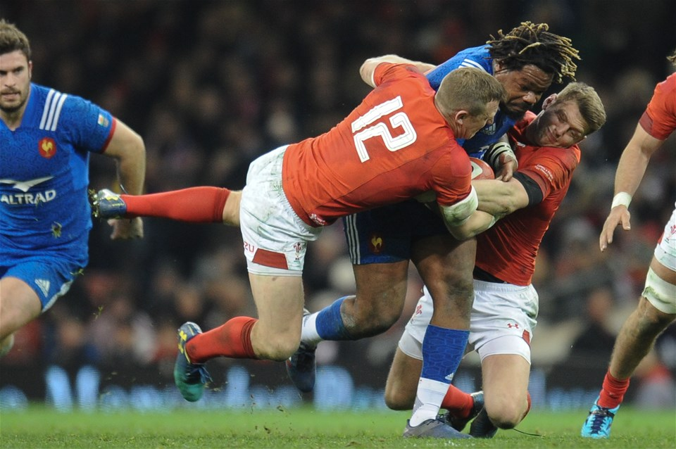 17.03.18 - Wales v France - NatWest 6 Nations Championship - Mathieu Bastareaud of France is tackled by Hadleigh Parkes of Wales and Dan Biggar of Wales