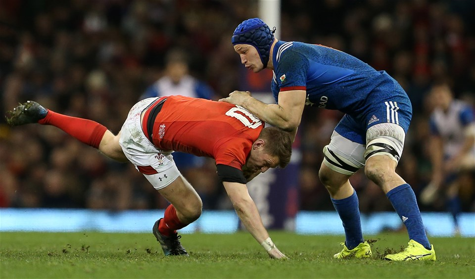 17.03.18 - Wales v France - Natwest 6 Nations Championship - Dan Biggar of Wales is dragged down by Wenceslas Lauret of France.