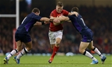 03.11.18 - Wales v Scotland - Under Armour Series - Gareth Anscombe of Wales is tackled by Allan Dell and Hamish Watson of Scotland.