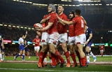 03.11.18 - Wales v Scotland - Under Armour Series - Jonathan Davies of Wales celebrates scoring a try with team mates.