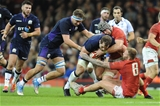 03.11.18 - Wales v Scotland - Under Armour Series - Fraser Brown of Scotland is tackled by Dan Lydiate of Wales  and Ross Moriarty of Wales