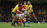 10.11.18 - Wales v Australia - Under Armour Series 2018 - Leigh Halfpenny of Wales is tackled by Dane Haylett-Petty and Israel Folau of Australia.