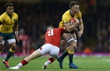 10.11.18 - Wales v Australia - Under Armour Series 2018 - Jack Dempsey of Australia is tackled by Gareth Davies of Wales.