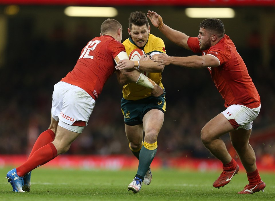 10.11.18 - Wales v Australia - Under Armour Series 2018 - Bernard Foley of Australia is tackled by Hadleigh Parkes and Nicky Smith of Wales.