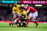 10.11.18 - Wales v Australia, Under Armour Series - Samu Kerevi of Australia tries to split the Wales defence