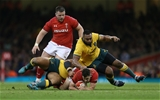 10.11.18 - Wales v Australia - Under Armour Series 2018 - Tomos Williams of Wales is tackled by Taniela Tupou and Sekope Kepu of Australia.