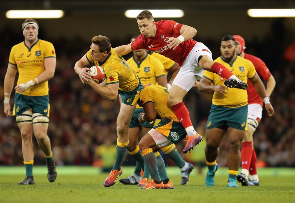 10.11.18 - Wales v Australia, Under Armour Series 2018 - Dane Haylett-Petty of Australia claims the ball as Liam Williams of Wales challenges
