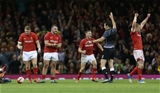 10.11.18 - Wales v Australia - Under Armour Series 2018 - Dan Biggar, Dillon Lewis and Gareth Anscombe and Hadleigh Parkes of Wales celebrate the victory at full time.