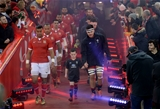 17.11.18 - Wales v Tonga - Under Armour Series - Siale Piutau of Tonga and Ellis Jenkins of Wales lead their teams out.