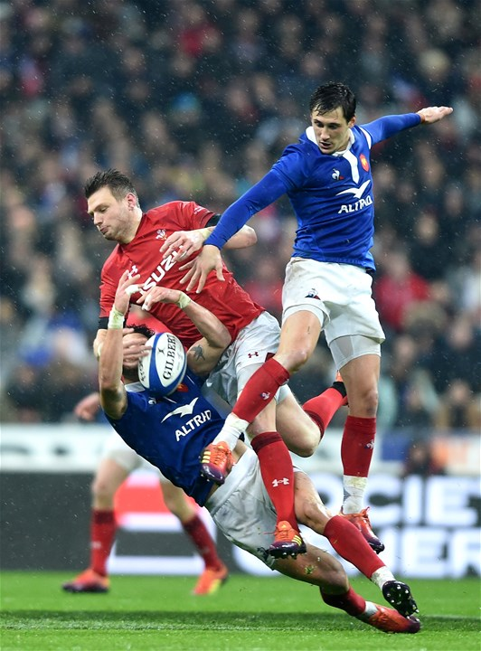 01.02.19 - France v Wales - Guinness 6 Nations 2019 -Dan Biggar of Wales goes up in the air agains Romain Ntamack and Baptiste Serin of France.
