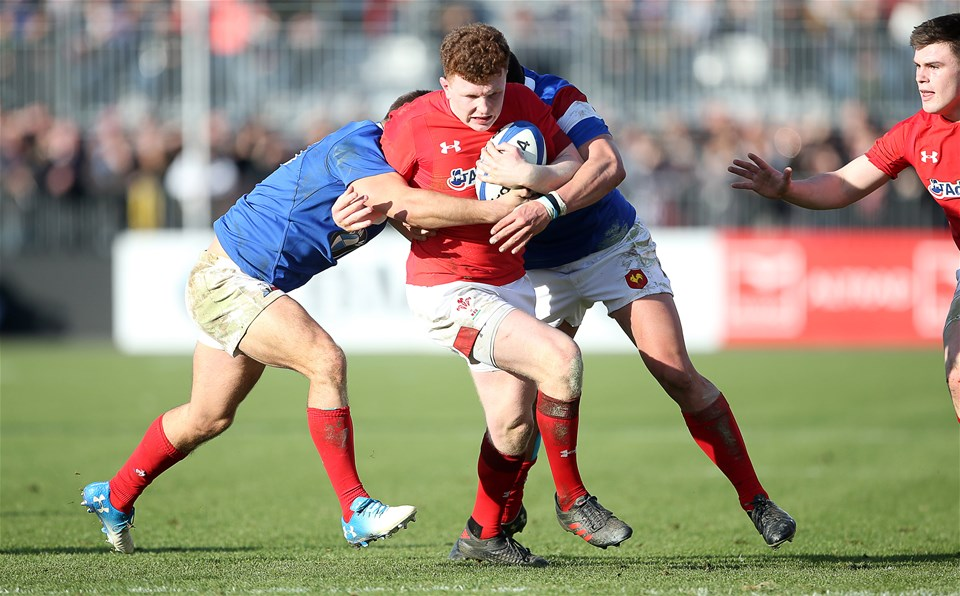 03.02.19 - France U20s v Wales U20s - U20s 6 Nations Championship - Aneurin Owen of Wales is tackled by Louis Carbonel and Julien Delbouis of France.