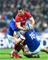 01.02.19 - France v Wales - Guinness 6 Nations 2019 -Gareth Davies of Wales is tackled by Baptiste Serin and Julien Marchand of France.