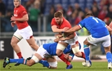09.02.19 - Italy v Wales - Guinness Six Nations -Thomas Young of Wales is tackled by Nicola Quaglio and Dean Budd of Italy.