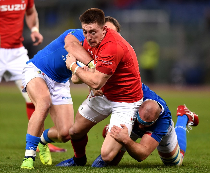 09.02.19 - Italy v Wales - Guinness Six Nations -Josh Adams of Wales is tackled by Michele Campagnaro and Leonardo Ghiraldini of Italy.