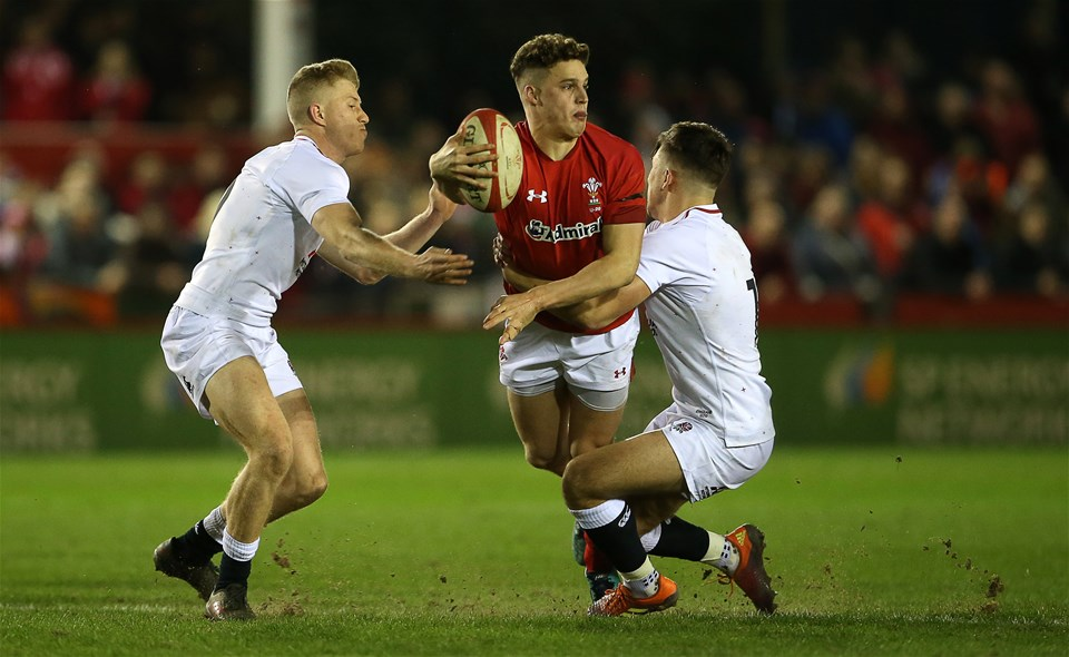 22.02.19 - Wales U20s v England U20s - U20s 6 Nations Championship - Tomi Lewis of Wales is tackled by Kieran Wilkinson of England.