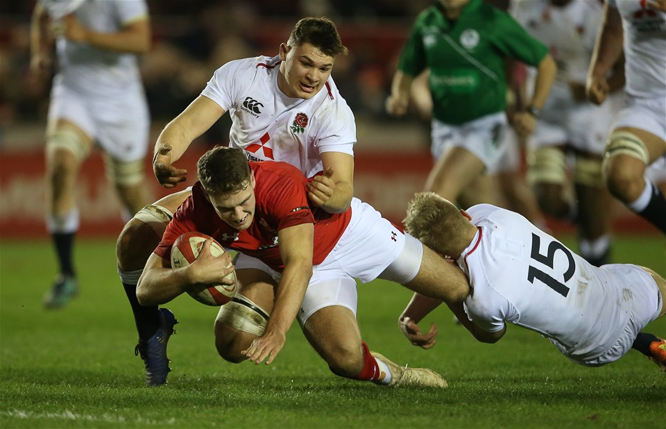 22.02.19 - Wales U20s v England U20s - U20s 6 Nations Championship - Max Llewellyn of Wales is tackled by Aaron Hinkley and Josh Hodge of England just short of the line.