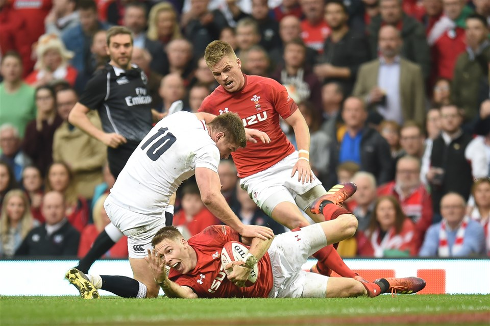 23.02.19 - Wales v England - Guinness Six Nations - Owen Farrell of England tackled Liam Williams of Wales