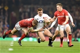 23.02.19 - Wales v England - Guinness Six Nations - Henry Slade of England is tackled by Hadleigh Parkes of Wales
