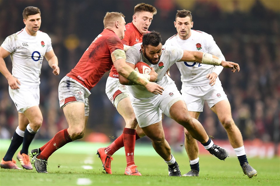 23.02.19 - Wales v England - Guinness Six Nations - Billy Vunipola of England is tackled by Josh Adams of Wales  and Hadleigh Parkes of Wales