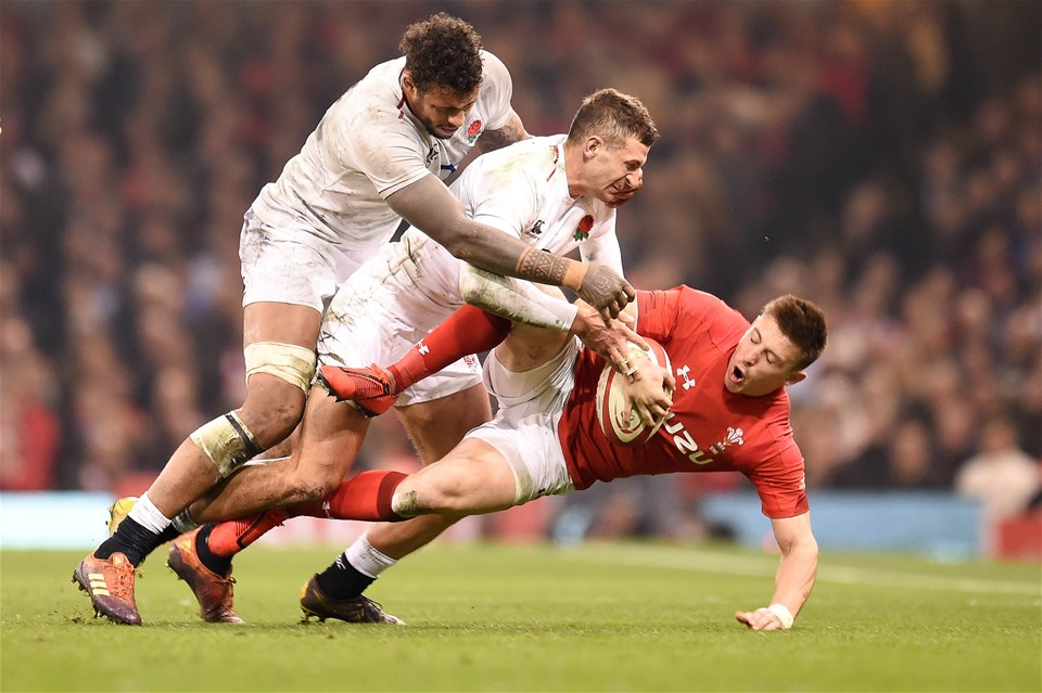 23.02.19 - Wales v England - Guinness Six Nations - Josh Adams of Wales  is tackled by Jonny May of England  and Courtney Lawes of England