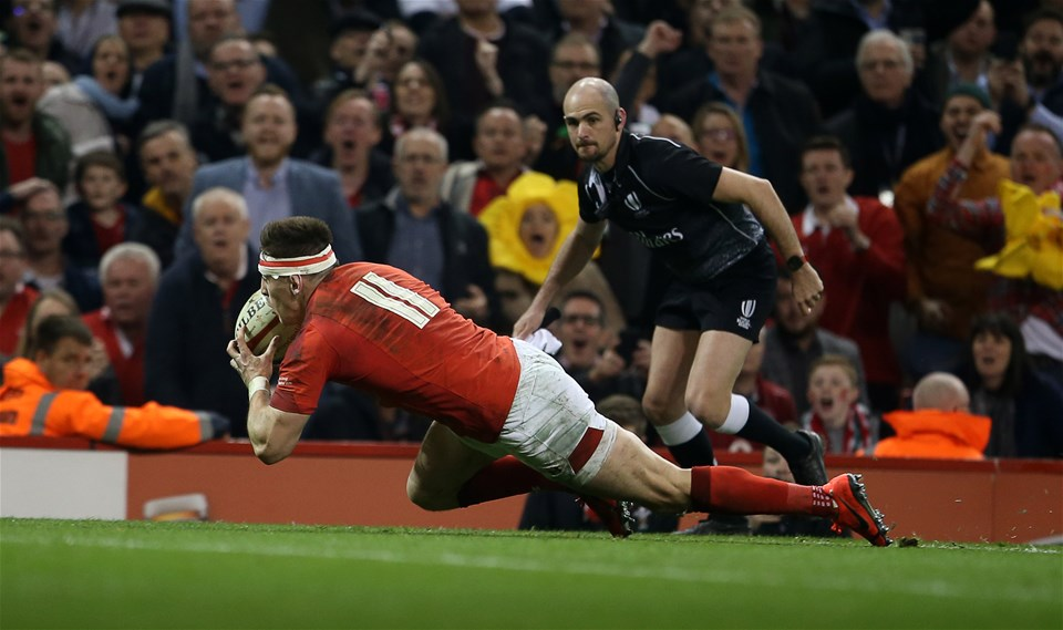 23.02.19 - Wales v England - Guinness 6 Nations Championship - Josh Adams of Wales beats Elliot Daly of England to score a try in the last few minutes of the match.