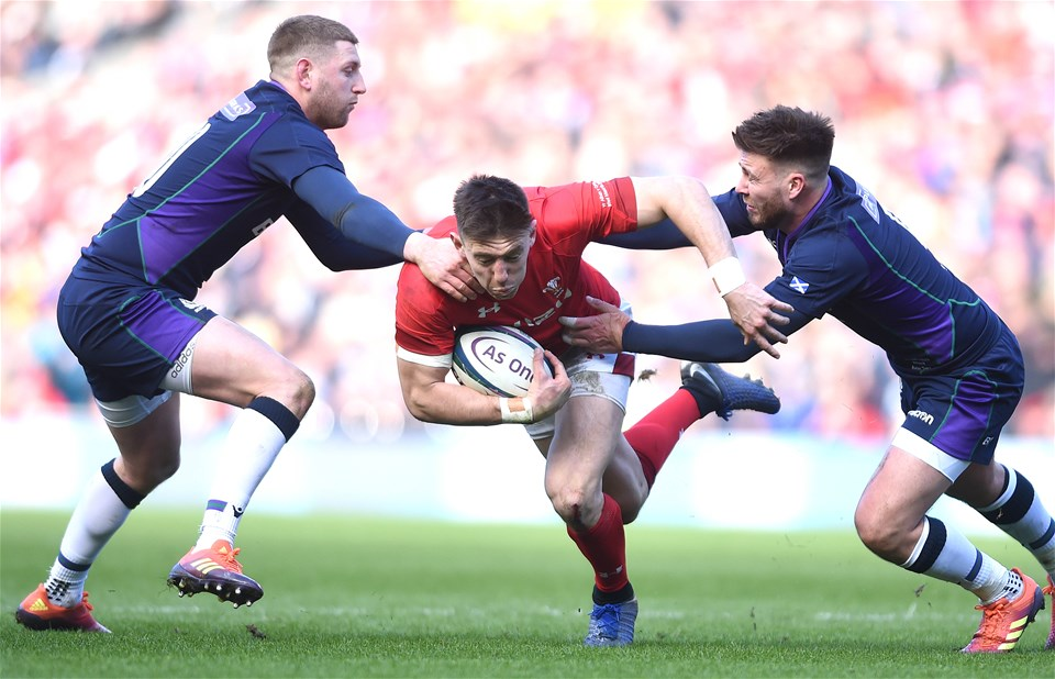 09.03.19 - Scotland v Wales - Guinness Six Nations -Josh Adams of Wales is tackled by Finn Russell and Ali Price of Scotland.