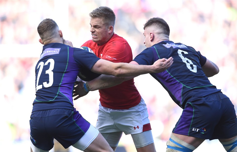 09.03.19 - Scotland v Wales - Guinness Six Nations -Gareth Anscombe of Wales is tackled by Byron McGuigan and Magnus Bradbury of Scotland.