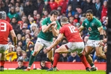 16.03.19 - Wales v Ireland - Guinness Six Nations - Jacob Stockdale of Ireland tries to pass Hadleigh Parkes of Wales