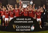 16.03.19 - Wales v Ireland - Guinness Six Nations - Alun Wyn Jones lifts the Six Nations Championship trophy and Jonathan Davies raises the Triple Crown.