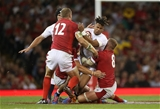 17.08.19 - Wales v England - RWC Warm Up - Under Armour Summer Series - Anthony Watson of England is tackled by Jonathan Davies and Ross Moriarty of Wales.