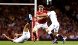 17.08.19 - Wales v England - Under Armour Summer Series -Aaron Wainwright of Wales is tackled by Jonathan Joseph and Piers Francis of England.