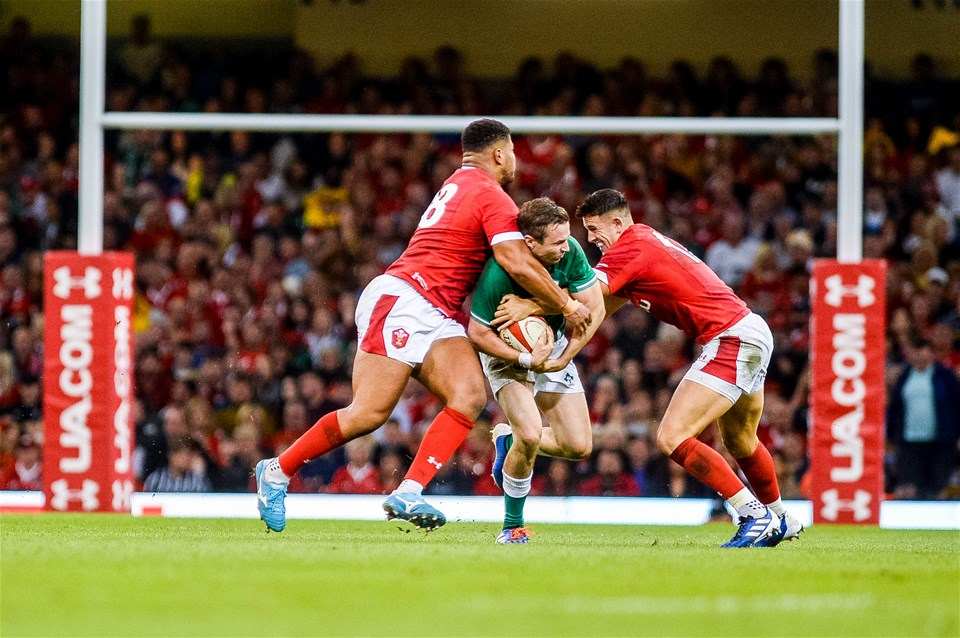 31.08.19 - Wales v Ireland, Under Armour Summer Series - RWC Warmup - Jack Carty of Ireland fights through with the ball