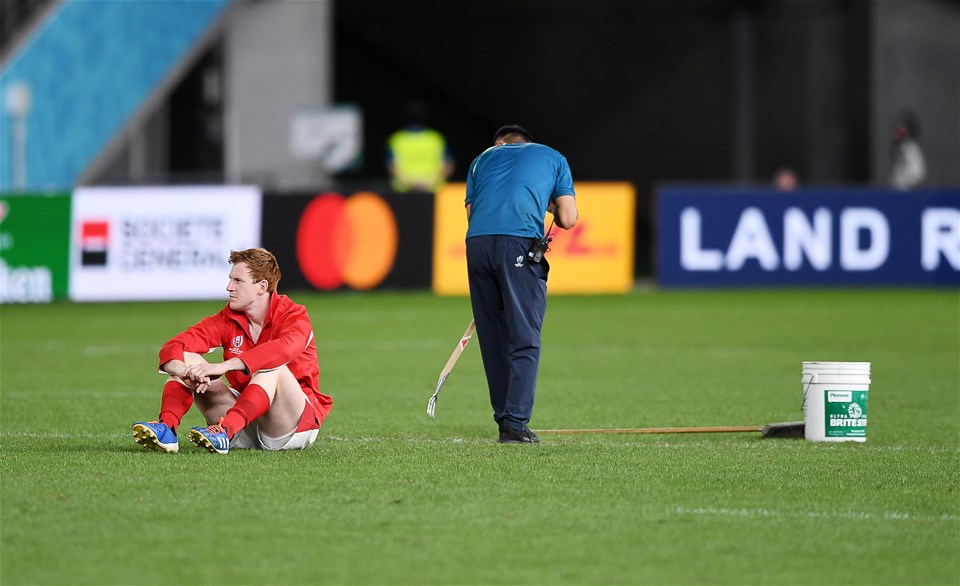 29.09.19 - Australia v Wales - Rugby World Cup - Rhys Patchell of Wales sits on his own after the game whilst grounds staff tend to the field.