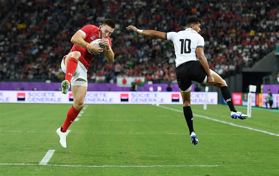 09.10.19 - Wales v Fiji - Rugby World Cup - Pool D - Josh Adams of Wales beats Ben Volavola of Fiji to score a try.