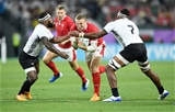 09.10.19 - Wales v Fiji - Rugby World Cup - Pool D - Hadleigh Parkes of Wales is tackled by Levani Botia and Semi Kunatani of Fiji.