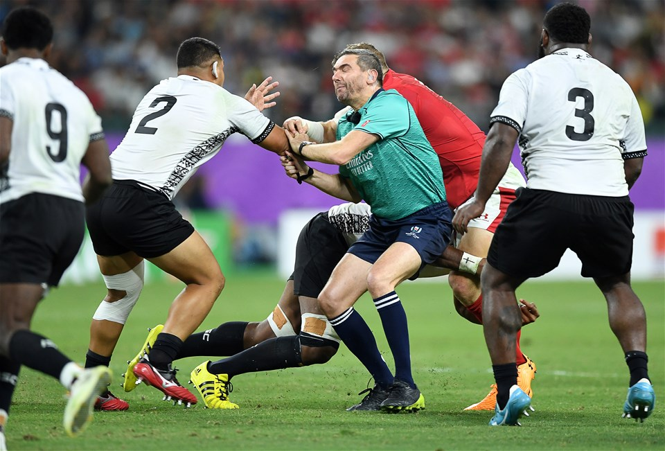 09.10.19 - Wales v Fiji - Rugby World Cup - Pool D - Referee Jerome Garces gets caught up in the play.