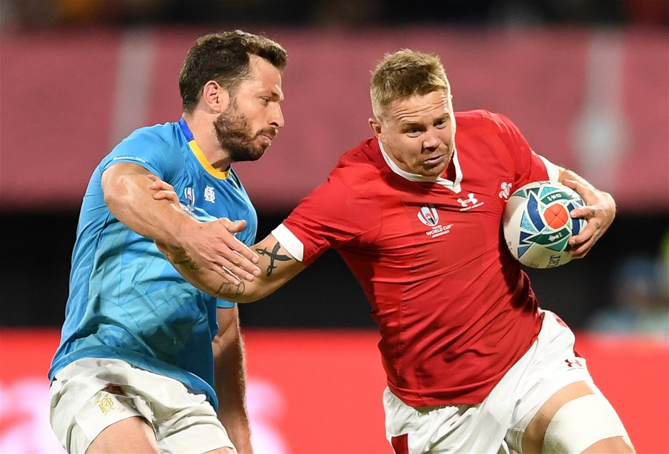 13.10.19 - Wales v Uruguay - Rugby World Cup - Pool D - James Davies of Wales is tackled by Felipe Berchesi of Uruguay.