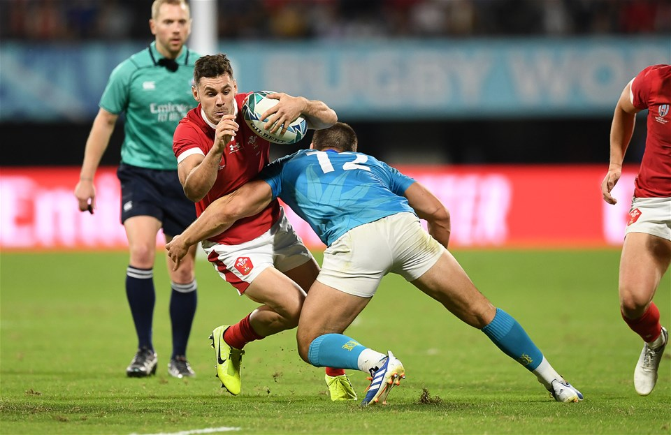 13.10.19 - Wales v Uruguay - Rugby World Cup - Pool D - Tomos Williams of Wales is tackled by Andres Vilaseca of Uruguay.