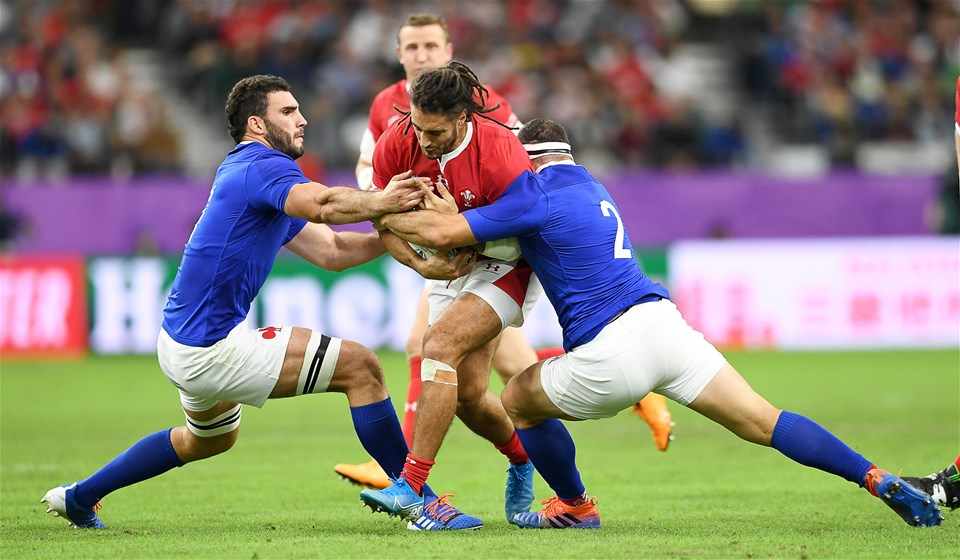 20.10.19 - Wales v France - Rugby World Cup Quarter Final - Josh Navidi of Wales is tackled by Charles Ollivon and Guilhem Guirado of France.