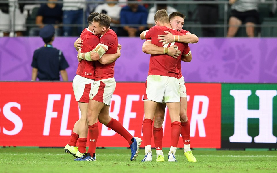 20.10.19 - Wales v France - Rugby World Cup Quarter Final - Tomos Williams celebrates with Dan Biggar and Liam Williams and Josh Adams of Wales celebrate at full time.