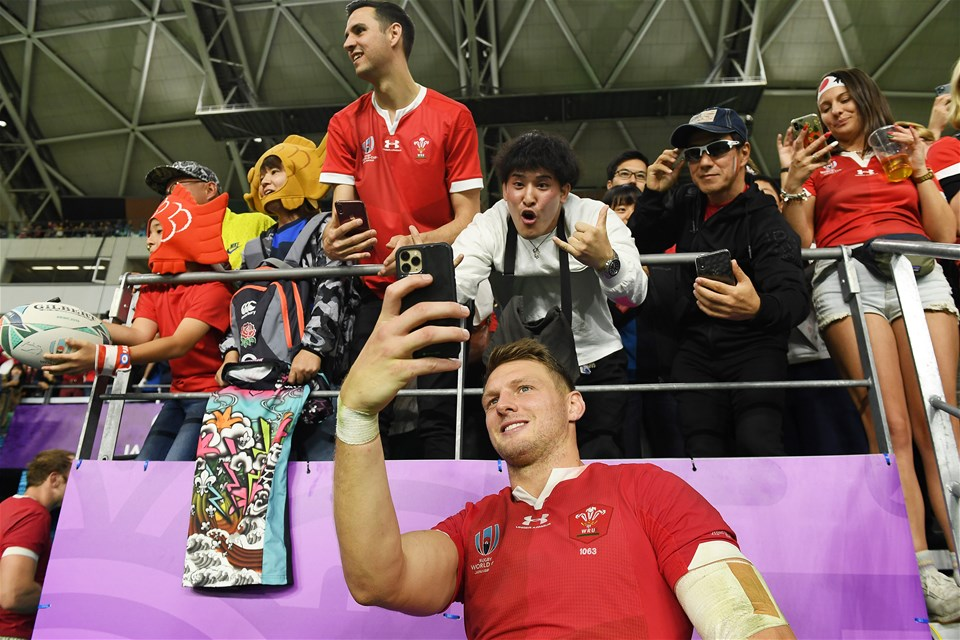 20.10.19 - Wales v France - Rugby World Cup Quarter Final - Dan Biggar of Wales takes a selfie with a fan at full time.