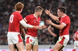 01.11.19 - New Zealand v Wales - Rugby World Cup Bronze Final - Hallam Amos of Wales celebrates scoring a try with Rhys Patchell and Josh Adams.