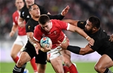01.11.19 - New Zealand v Wales - Rugby World Cup Bronze Final - Josh Adams of Wales is tackled by Aaron Smith and Nepo Laulala of New Zealand.